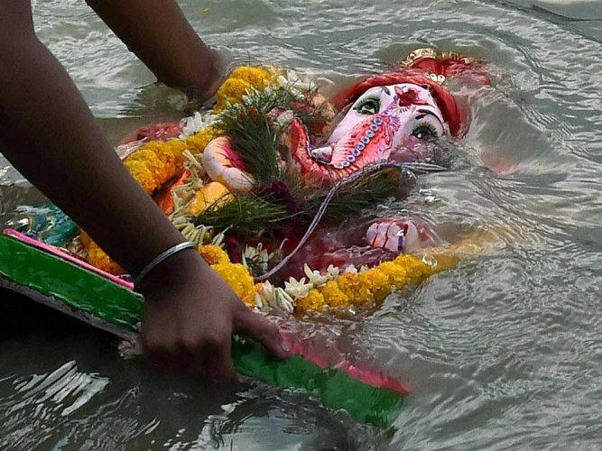 Volunteers from Environmentalist Foundation of India are gearing up to clean three lakes after the Ganesha festival. PTI file photo