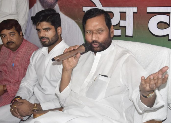 Union minister and Lok Janshakti Party chief Ram Vilas Paswan and his son Chirag during press conference at the party office in Patna. PTI File Photo