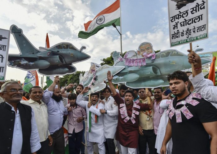 Congress Party supporters protest against the alleged corruption in Rafale Deal, in New Delhi. PTI Photo
