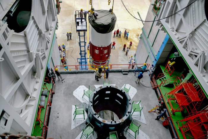 Nozzle end segment of PSLV-C42 first stage is placed over the launch pedestal as preparations are underway for the first-ever commercial launch by ISRO, of two UK satellites Novasar and S1-4, from the spaceport of Sriharikota near Chennai. PTI