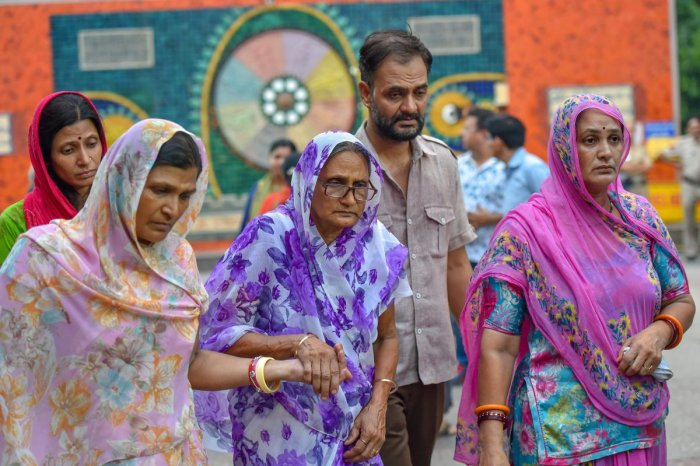 Relatives mourn during the cremation of 11 members of a family, who were found hanging in their house in Burari, at Nigambodh Ghat in New Delhi on Monday, July 2, 2018. (PTI File Photo)