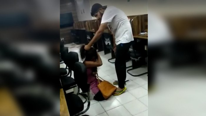 The son of a policeman, who is seen beating and kicking a woman in a video was arrested on charges of rape
