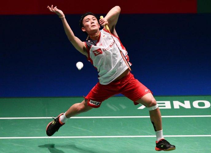 Japan's Kento Momota smashes against Denmark's Viktor Axelsen during the men's semifinal match in Tokyo on Saturday. AFP