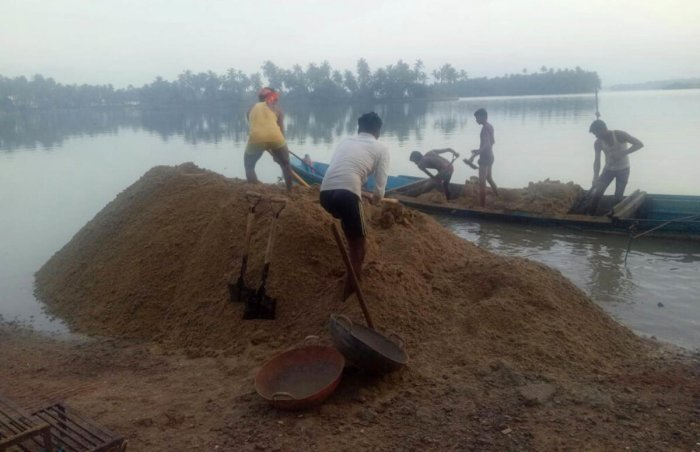 A file photo of sand being mined in the Coastal Regulation Zone in Udupi district.