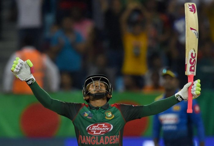 Bangladeshi batsman Mushfiqur Rahim celebrates after scoring 100 runs during the one day international (ODI) Asia Cup cricket match between Bangladesh and Sri Lanka at the Dubai International Cricket Stadium in Dubai on September 15, 2018. (AFP Photo)