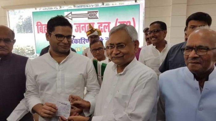 Prashant Kishor with Nitish Kumar, shortly after joining the JD(U) in Patna on Sunday. (DH Photo)