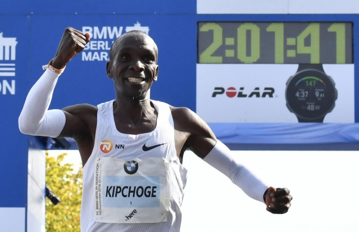 Eluid Kiipchoge celebrates after winning the Berlin Marathon in a new world record. AFP
