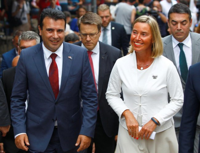 Macedonian Prime Minister Zoran Zaev and EU foreign policy chief Federica Mogherini walk through the Old Bazaar in Skopje, Macedonia September 13, 2018. Reuters