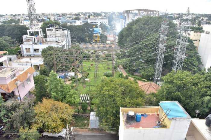 High-tension wires hover over the BBMP park in Rajajinagar 5th Block. DH PHOTOS/Janardhan B K