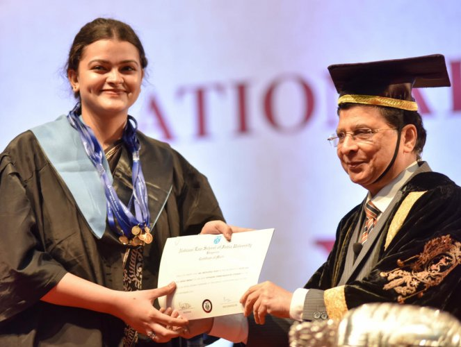 Chief Justice of India Dipak Misra presents a certificate to Bhuvanyaa Vijay at the 26th annual convocation of the National Law School of India University on Sunday. DH Photo/B H Shivakumar