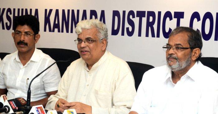 KPCC Vice President Prof Radhakrishna addresses a press meet in Mangaluru on Monday.