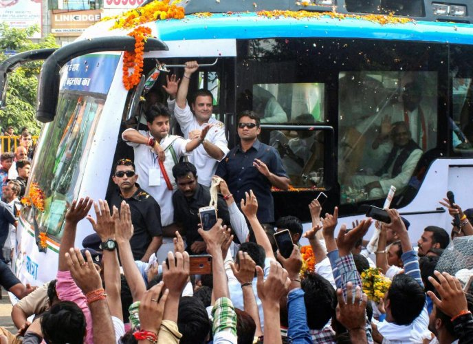 Congress President Rahul Gandhi waves to his party supporters and workers during a roadshow, in Bhopal, Monday, Sept 17, 2018. (PTI Photo)
