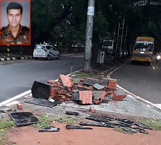 A plaque of Major Sandeep Unnikrishnan (inset) that was damaged by a truck in Yelahanka.