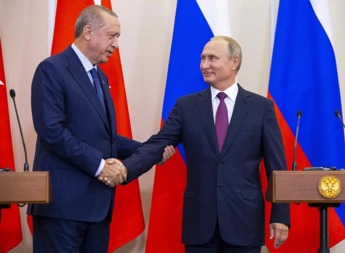 Turkish president Tayyip Erdogan and his Russian counterpart Vladimir Putin shake hands during a news conference following their talks in Sochi, Russia on September 17, 2018. Reuters