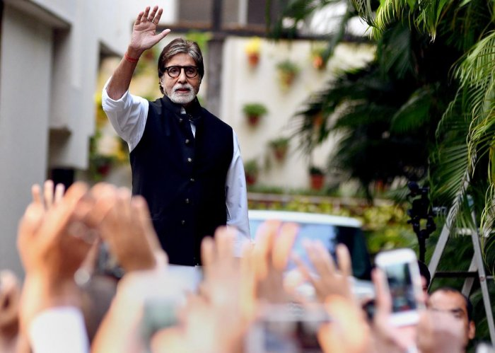 Amitabh Bachchan waves to his fans at his residence in Mumbai. PTI File Photo