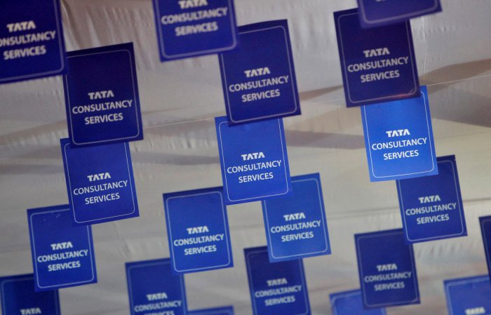 FILE PHOTO: Logos of Tata Consultancy Services (TCS) are displayed at the venue of the annual general meeting of the software services provider in Mumbai.