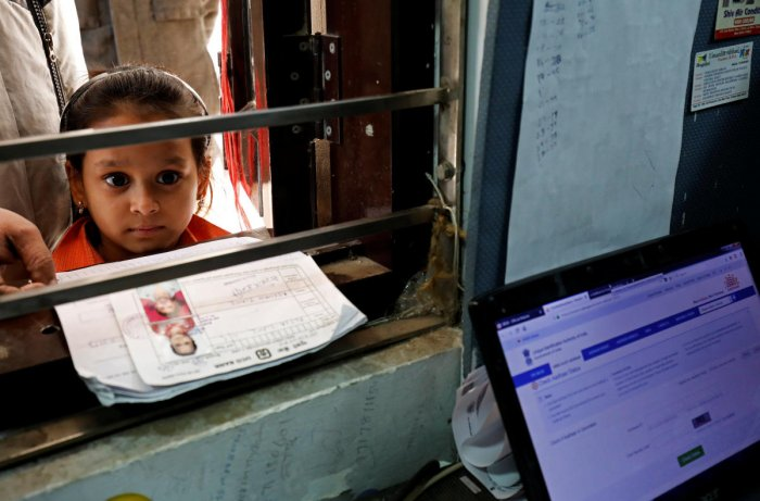It has also exhorted schools to co-ordinate with local banks, post offices, state education department and district administration, to facilitate special camps in their premises for Aadhaar enrolment and updation. (Reuters File Photo)
