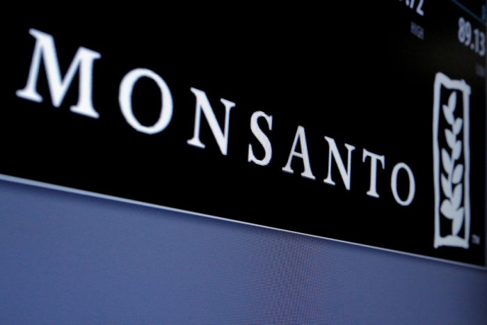 FILE PHOTO: Monsanto is displayed on a screen where the stock is traded on the floor of the New York Stock Exchange (NYSE) in New York City, U.S., May 9, 2016. REUTERS/Brendan McDermid/File Photo