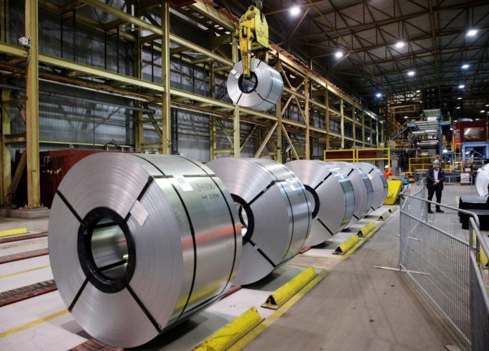 FILE PHOTO: Rolled up steel sits in the ArcelorMittal Dofasco steel plant in Hamilton, Ontario, Canada, March 13, 2018. Reuters