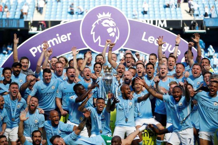 Triumphant: Manchester City celebrate with the Premier League trophy on Sunday. Reuters