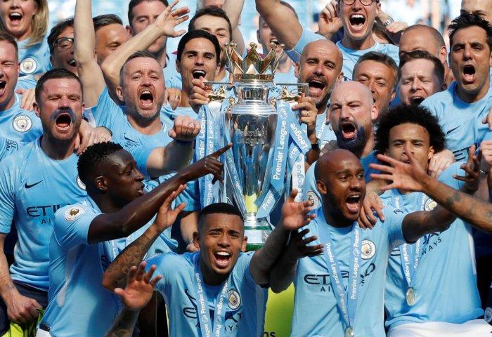 Manchester City players with the Premier League title. REUTERS