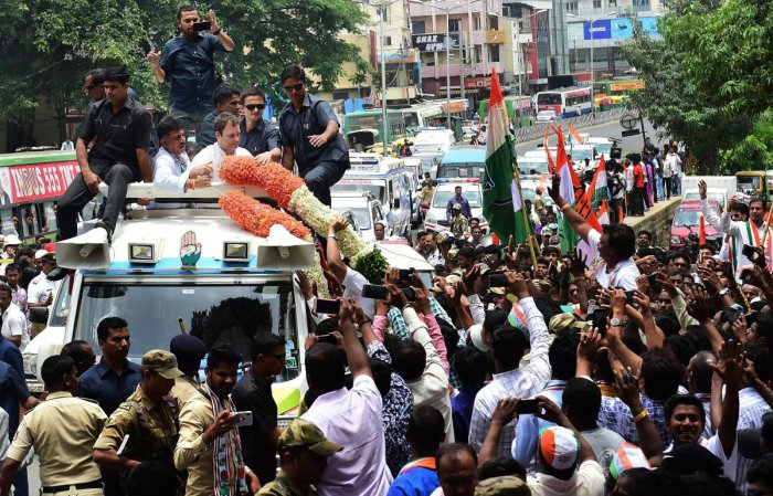 AICC President Rahul Gandhi waves at his supporters during a road show ahead of the Karnataka Assembly election in Bengaluru on Wednesday. PTI Photo