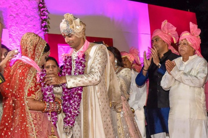 RJD chief Lalu Prasad's elder son Tej Pratap and Aishwarya Rai during their wedding ceremony at Veterinary College Ground in Patna on Saturday. PTI