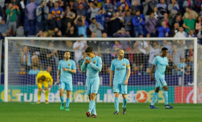 Barcelona's Philippe Coutinho and Andres Iniesta look dejected after losing to Levante. REUTERS