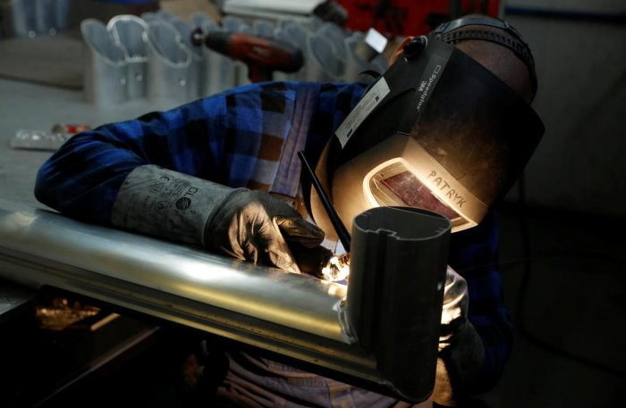 A worker welds the aluminium part of a goal at Interplastic, a Polish manufacturing company who are supplying the football goalposts for the 2018 World Cup finals in Russia, in Chwaszczyno, Poland, May 16, 2018. Picture taken May 16, 2018. REUTERS/Kacper