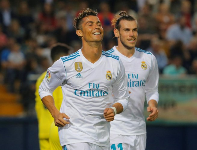 Deadly duo: Real Madrid's Cristiano Ronaldo celebrates with team-mate Gareth Bale after scoring against  Villarreal. REUTERS