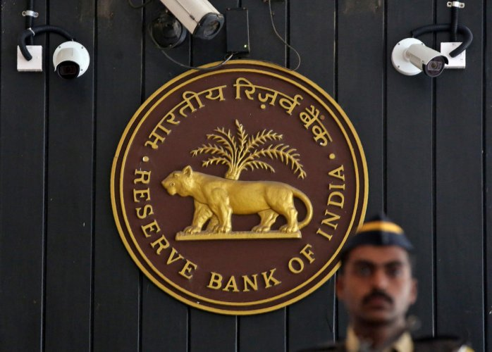 FILE PHOTO: A security personnel member stands guard at the entrance of the Reserve Bank of India (RBI) headquarters in Mumbai, India, August 2, 2017. REUTERS