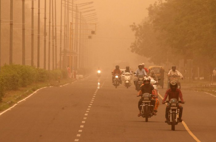 Commuters make their way amidst haze and dust in Chandigarh. (Reuters)