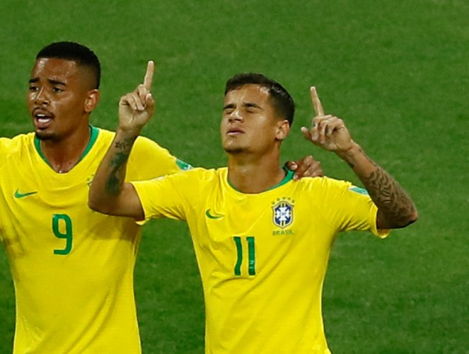 Philippe Coutinho (right) celebrates with Gabriel Jesus after scoring against Switzerland. REUTERS