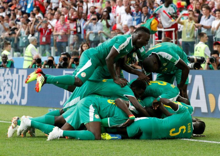 Senegal's M'Baye Niang celebrates scoring their second goal with teammates. (Reuters Photo)