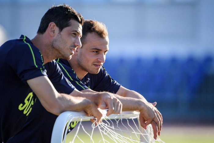 Switzerland's Blerim Dzemaili (left) and Xherdan Shaqiri at a training session. AFP
