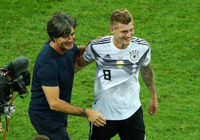 Germany coach Joachim Low and Toni Kroos celebrate after the match REUTERS.
