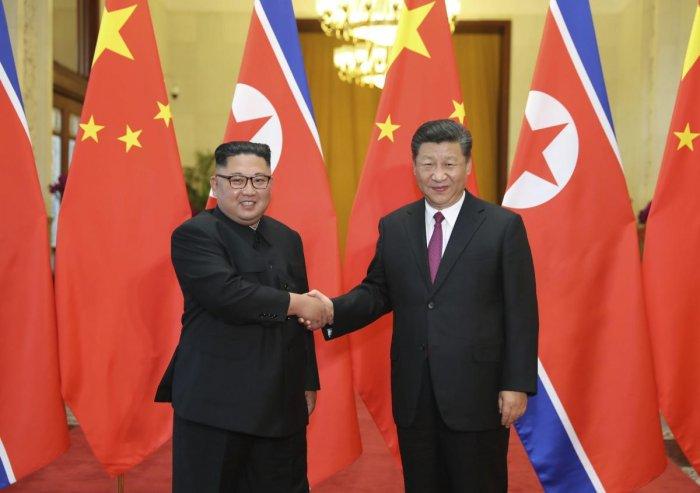 Chinese President Xi Jinping poses with North Korean leader Kim Jong Un. AP/PTI file photo