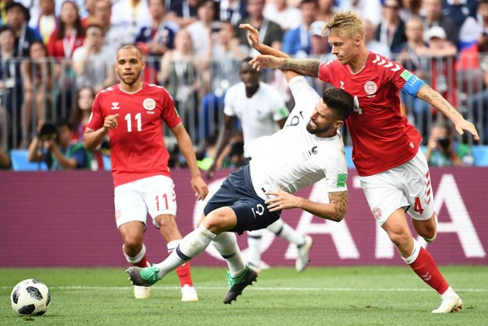 France's forward Olivier Giroud (L) vies with Denmark's defender Simon Kjaer during the Russia 2018 World Cup Group C football match between Denmark and France at the Luzhniki Stadium in Moscow. AFP