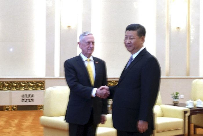 U.S. Defense Secretary Jim Mattis, left, shakes hands with Chinese President Xi Jinping as they pose for photographers before a meeting at the Great Hall of the People in Beijing, Wednesday, June 27, 2018. AP/PTI