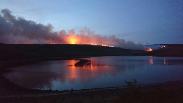 Firefighters battling a rare large wildfire in northern England, which has sparked the evacuation of dozens of homes, are being hampered by changeable winds and combustible peat, officials said Wednesday. Picture courtesy Twitter