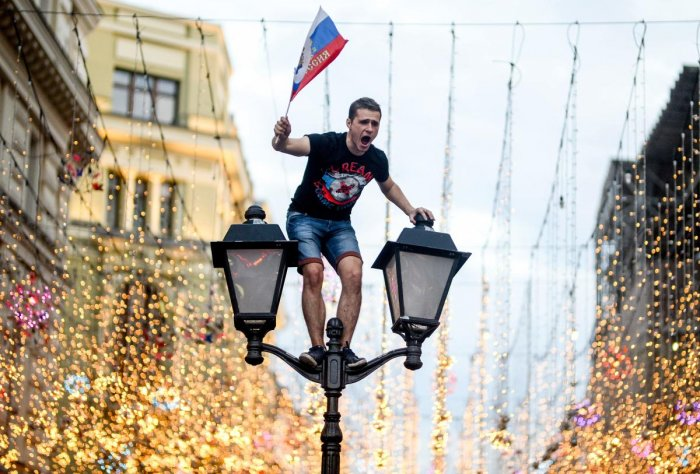 ECSTATIC A Russian fan celebrates in central Moscow after his country's win over Spain. AFP