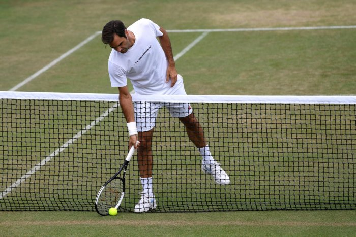 CRUISING ALONG Roger Federer during a practice session on Sunday, ahead of his Monday's fourth-round clash at Wimbledon. Reuters