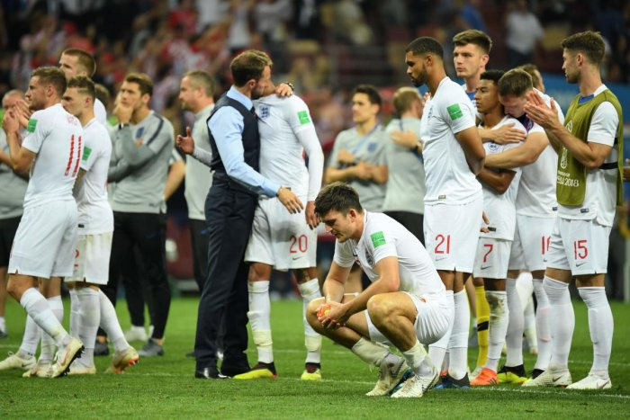 CRESTFALLEN England players look completely distraught after losing to Croatia in the semifinals of the World Cup on Wednesday. AFP