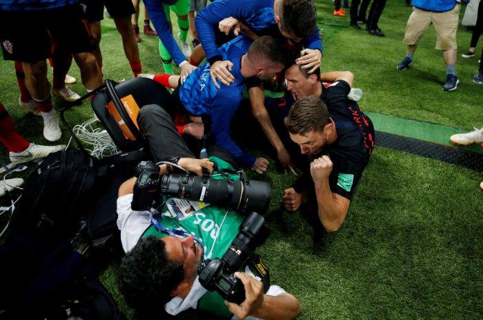 Croatia players celebrate next to an AFP photographer Yuri Cortez after Mario Mandzukic scored their second goal. REUTERS