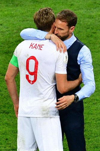 SHOULDER TO CRY England coach Gareth Southgate embraces his captain Harry Kane after the semifinal defeat against Croatia. AFP