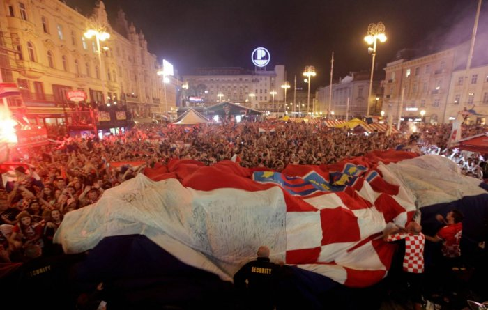 Croatian fans celebrate at the end of the FIFA World Cup semifinal match against England, in Zagreb on Wednesday. (AP/PTI)