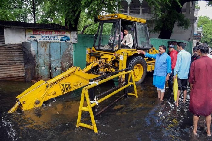 Mayor Alok Sharma (in blue kurta) inspects the relief works while taking stock of the situation after a heavy downpour in Bhopal on Thursday. PTI