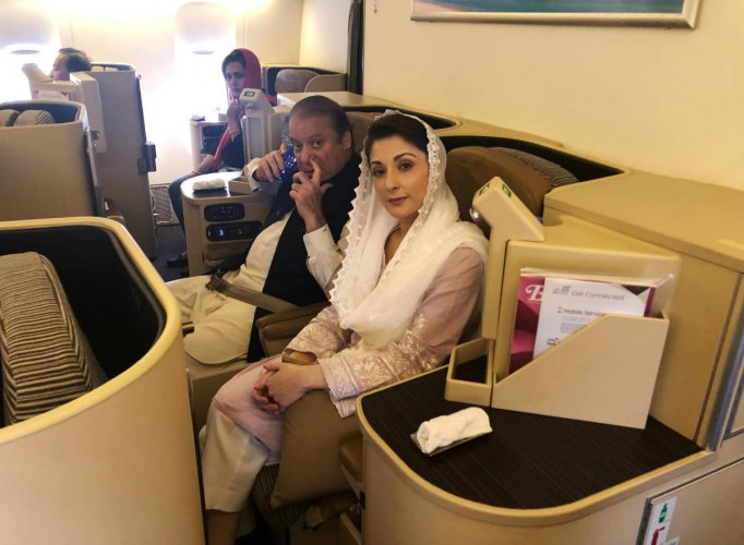 Ousted Pakistani Prime Minister Nawaz Sharif and his daughter Maryam sit on a Lahore-bound flight due for departure, at Abu Dhabi International Airport, UAE on Friday. (REUTERS/Drazen Gorgic)