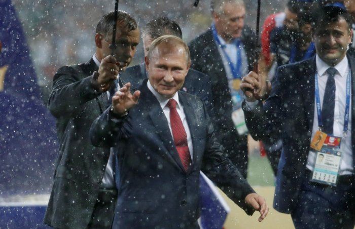President of Russia Vladimir Putin on the pitch after the medals ceremony. REUTERS