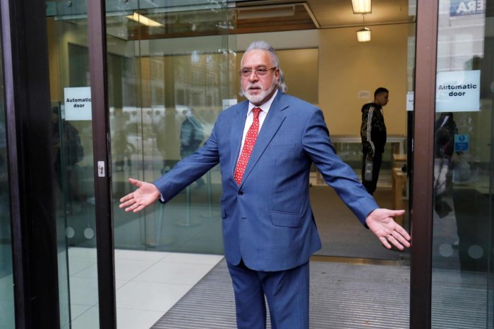 Vijay Mallya gestures to members of the media as he leaves after appearing at Westminster Magistrates Court in central London on Tuesday. AFP